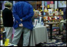 [Howard Zinn raw #23: Zinn signs books]